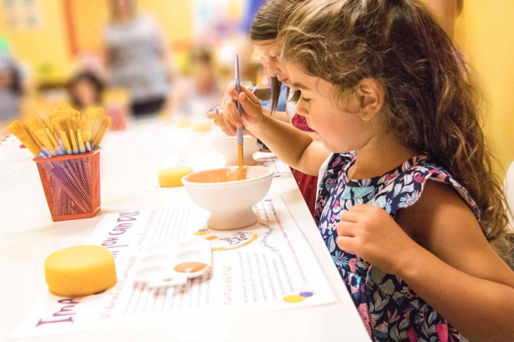 Kids painting at Crock A Doodle is one of the top things to do in Blue Mountain Village