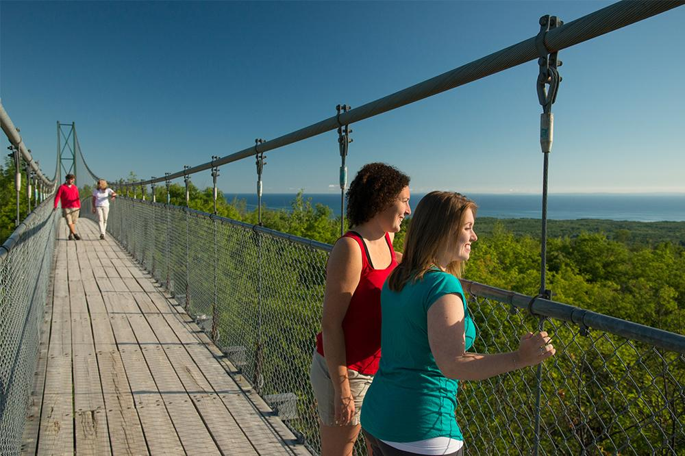 Women staning on the suspension bridge at Blue Mountains Scenic Caves