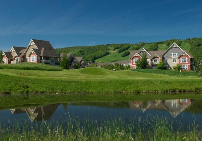 Blue Mountain Village resorts and golf course with ski hills in background during the summer months